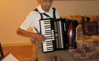 <p>Al Elko playing the accordion</p>