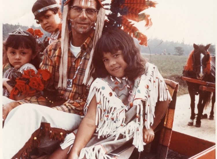 <p>A father and his three children pose for photographer William Bradshaw at the Chickahominy Reservation in Charles City County in 1969. Courtesy of Valentine Richmond History Center.>