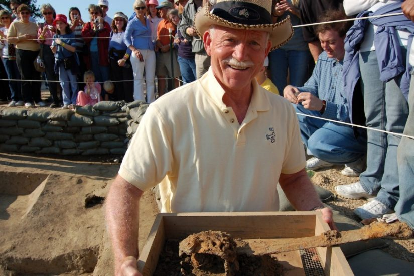 Archaeologist Bill Kelso poses with artifacts excavated from the orginial Jamestown settlement in the 1990s. <i>Photograph by Benjamin Knowles. Courtesy of Preservation Virginia.</i>