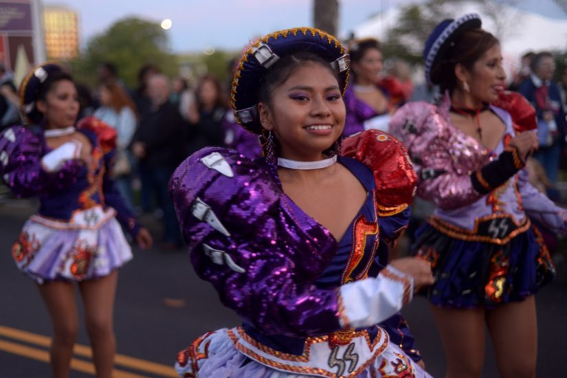 Traditional Bolivian dancers parade through the Richmond Folk Festival. Photo by Pat Jarrett/The Virginia Folklife Program