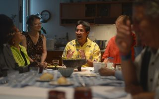 Walter Tejada shares a story. Community leaders gathered to discuss food and community traditions at the home of John Andelin and Ginger Geoffrey in Arlington, Virginia. Pat Jarrett/VFH Staff