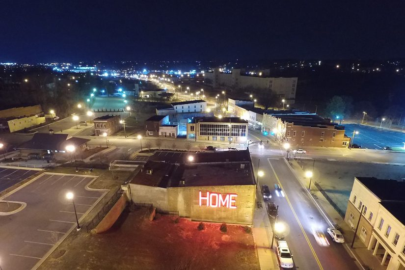 "The former Dan River Fabrics building in Danville.  Installation of the ""Home"" sign was a community event sponsored by the History United Project and the Danville Historical Society in 2016.  Photo courtesy of Mark Aron and the Danville Regional Foundation."
