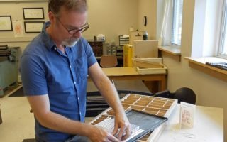 Book artist Frank Brannon at work, sorting Cherokee syllabary type - Wikimedia Commons