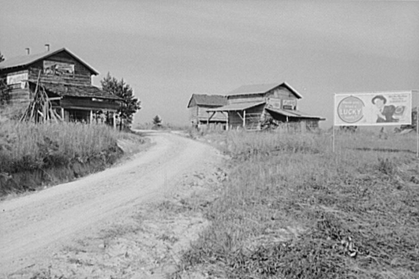 """Marion Post Wolcott, """"Tobacco Barns and Cigarette Advertisements,"""" 1940."""