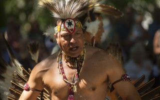 Preston Adkins (Chickahominy) dances at the ground breaking of Mantle, a tribute to Virginia Indians