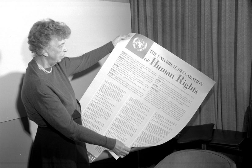 Eleanor Roosevelt holding the UDHR