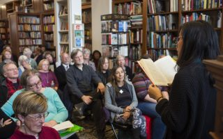 The inaugural Carol Troxell Reader, Lisa Ko, reads from her book The Leavers at New Dominion Bookshop in Charlottesville on March 22, 2018. The event was part of the Virginia Festival of the Book. - Photo by Pat Jarrett