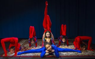 Contortionist Mandkhai Erdembat pictured with her apprentices and first students on the set of Erdembat's show, 'Contortionist's Seed' - Photo by Pat Jarrett