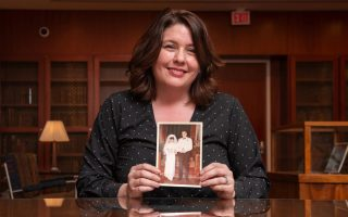 Kim O'Connell holds a photo of her parents on their wedding day. - Photo by Pierre Courtois, Library of Virginia