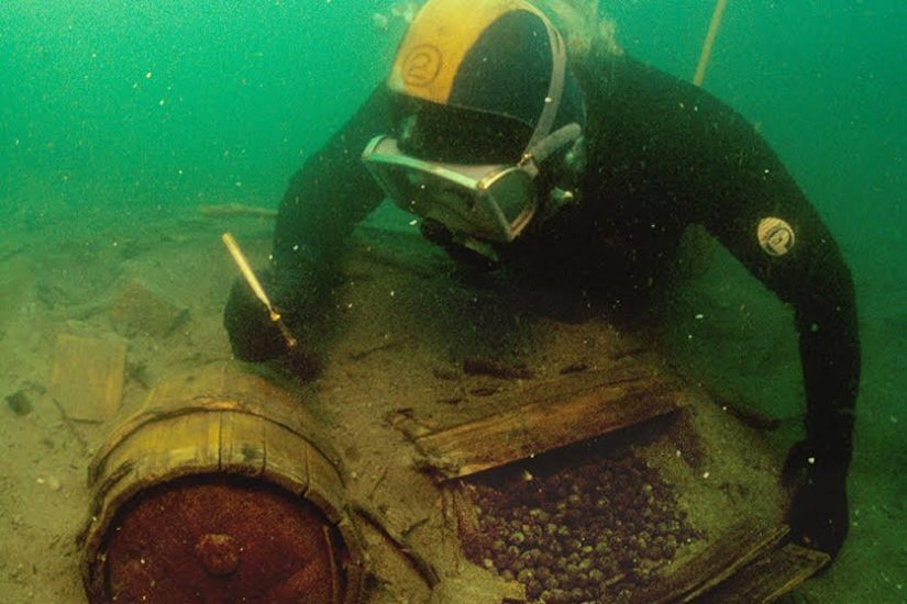 An archaeologist recovers musketball casks from the Betsy shipwreck. Image courtesy DHR.
