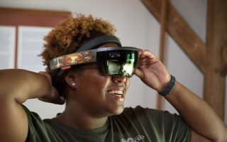 Niya Bates, Director of African American History and Getting Word Oral History Project at Monticello, tries on an augmented reality headset. - Photo by Peter Hedlund, Virginia Humanities